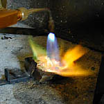 Melting the metal with a torch